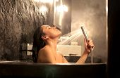 image of douche  - Beautiful woman having a shower in a bathtub - JPG