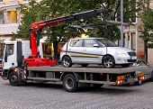 stock photo of towing  - Tow Away Car in The Center Of The City - JPG