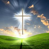stock photo of christianity  - Christian cross against the sky in a blaze of glory - JPG