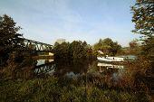 foto of flatboat  - a cargo boat going undernath bridge - JPG