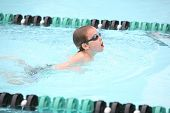 Boy swimming breaststroke