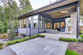 New Modern Home Features A Backyard With Patio poster