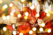 Toasting Red Wine With Light Bokeh poster