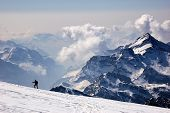 foto of mountain-climber  - Mountaineer walking on a glacier West Alps Swiss - JPG