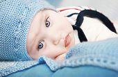 stock photo of newborn baby  - Portrait of a cute newborn baby boy sleeping - JPG