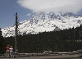 Tourists Looking At Mount Rainier poster