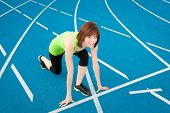 Athletic Woman On A Running Track