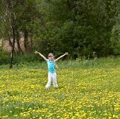 picture of hands up  - Little girl on meadow outdoor  with hand up - JPG