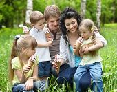 Family with kids eating ice-cream. Outdoor.