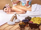 foto of day care center  - Young beautiful woman on massage table in beauty spa - JPG
