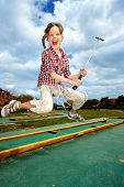 pic of miniature golf  - Children playing golf in park - JPG