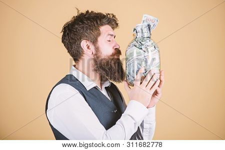 poster of Attractive Investment. Bearded Man Investor Kissing Glass Jar With Investment Money. Successful Busi