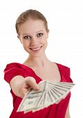 Beautiful Cheerful Girl In A Red Blouse Holds Out A Wad Of Money, American Dollars Isolated