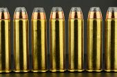 image of hollow point  - 357 jacketed hollow point pistol ammunition in a row - JPG