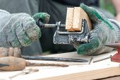 Carpenter Is Clamping A Wooden Billet In Clamp. poster