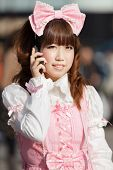 japanese lolita cosplay woman phoning, tokyo