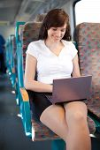 Young Businesswoman Staying Busy On The Train / Bus