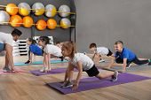 Cute Little Children And Trainer Doing Physical Exercise In School Gym. Healthy Lifestyle poster