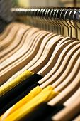 pic of clothes hanger  - Clothes hangers with shirts in the fashion store - JPG