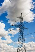Power Pylons And High-voltage Lines Against The Background Of The Cloudy Sky, Power Lines. poster