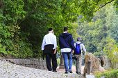 Older Hasidic Jews Walk In The Sofia Park During The Jewish New Year In Uman, Ukraine. Religious Jew poster
