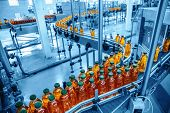 Conveyor Belt, Juice In Bottles On Beverage Plant Or Factory Interior In Blue Color, Industrial Prod poster