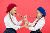 Bullying And Aggression. Naughty Children Pulling Pigtails On Pink Background. Small Girls With Bull poster