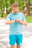 Combining Technology With Style. Fit Man Tracking His Performance With Sports Watch Technology. Hand poster