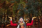 Autumn Forest Leisure. Portrait Of Happy Lady Enjoying Time In Fall Nature Park. Blur Trees And Fall poster