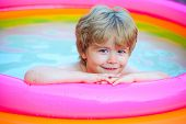 Child Water Toys. Kids Happy. Children Playing In Pool. Happy Child Having Fun At Swimming Pool On S poster
