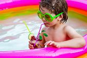 Vacation At Paradise. Child Boy And Best Swimming Pool. Child Water Toys. Kids Beach Fun. Enjoying I poster