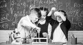 Chemistry Equipment. Students Doing Experiments With Microscope In Lab. Happy Children. Chemistry Le poster