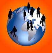 stock photo of person silhouette  - silhouettes of business people on a global background - JPG