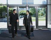 Businessmen entering building