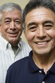 Close up portrait of two elderly men