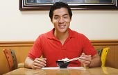Portrait of Asian man eating rice