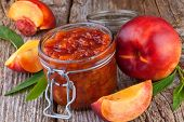 nectarine peach jam on wooden background
