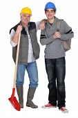 stock photo of school-leaver  - Experienced tradesman welcoming his new apprentice - JPG