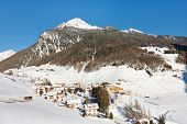 Sunny Winter Day At Idyllic Alpine Village