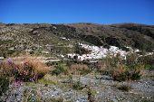 White village in mountains, Torvizcon, Andalusia, Spain.