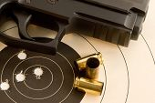 stock photo of top-gun  - Target with bullseye shot by 40 caliber handgun - JPG