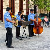 HAVANA-JANUARY 16:Traditional band playing for tourists January 16,2013 in Havana.Famous through the world,the cuban music is an attraction for more than 2 million people who visit Cuba every year