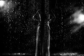 Black And White Abstract Fashion Portrait Of Young Woman In The Rain