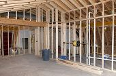 stock photo of reconstruction  - New Room addition construction to existing home - JPG