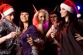 stock photo of party people  - Portrait of modern young people enjoying themselves at New Year party - JPG