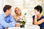 stock photo of mother law  - happy young man meeting mother in law with his wife - JPG