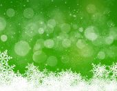 Abstract green and white christmas background with snowflakes