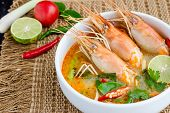 foto of thai cuisine  - Tom yam kung or Tom yum Tom yam is a spicy clear soup typical in Thailand and No - JPG
