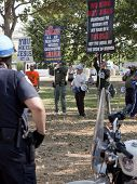 WASHINGTON-SEPT 11: Men opposed to the 9/11 Truthers stand behind police on September 11, 2013 in Wa