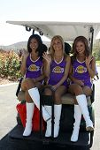 MOOREPARK, CA - SEPT 16:  Laker Girls head out to the course at the 6th Annual Scott Medlock & Robby Krieger Golf Invitational & All-Star Concert on September 16, 2013 in Moorepark CA.